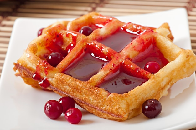 Waffles with cranberry syrup Free Photo