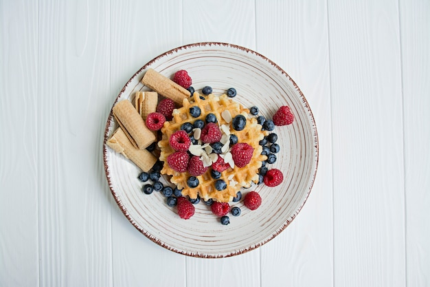 Waffles with fresh fruit for breakfast. sunny waffles. Premium Photo