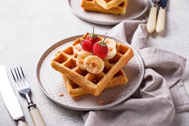 Waffles with strawberries and banana Premium Photo