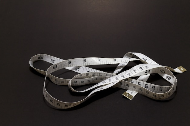 Waist measurement on black background Premium Photo