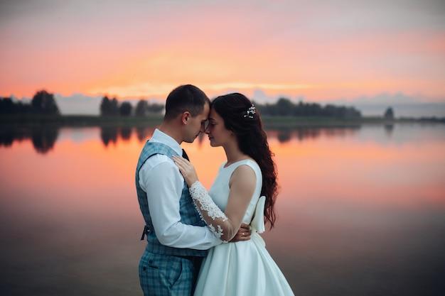 Waist up of romantic wedding couple hugging Premium Photo