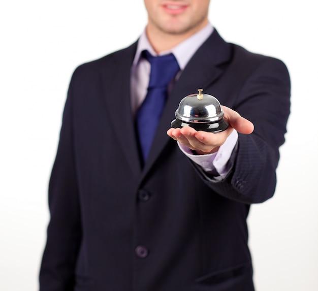 Waiter holding a hotel bell Premium Photo