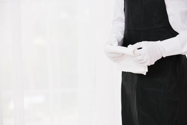 Waiter in uniform holding cloth Free Photo
