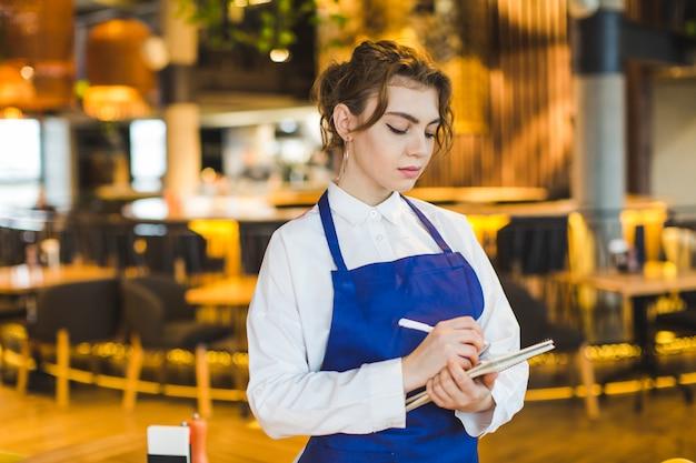 Waitress in restaurant Free Photo