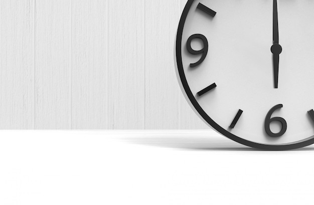 A wake up time at six clock on copy space white wood floor background. Premium Photo