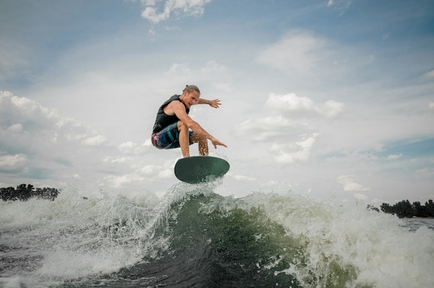 Wakesurf rider jumping on the waves of the river Premium Photo