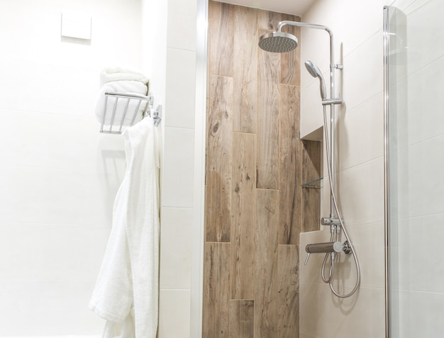 Walk in shower in bathroom with wooden style tile Premium Photo