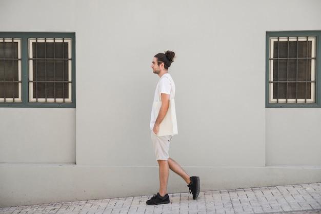 Walking by the sidewalk Premium Photo