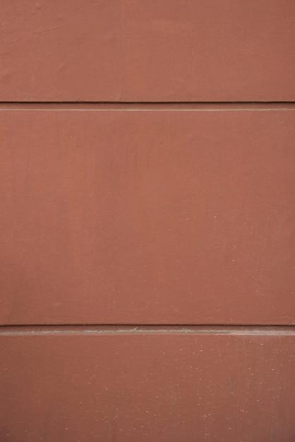 Wall of brown rock blocks Free Photo