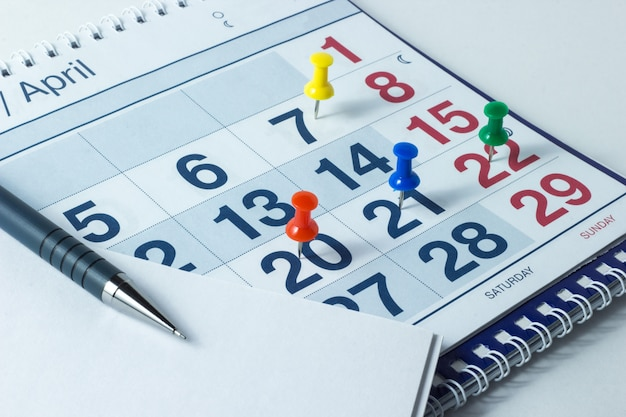 Wall Calendar And Pen Important Days Are Marked With Knops Photo