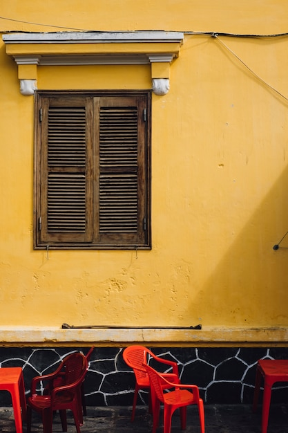 Wall and chairs on street in hoi an, vietnam Free Photo