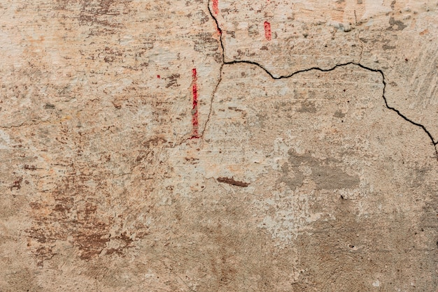 Wall fragment with scratches and cracks background Premium Photo