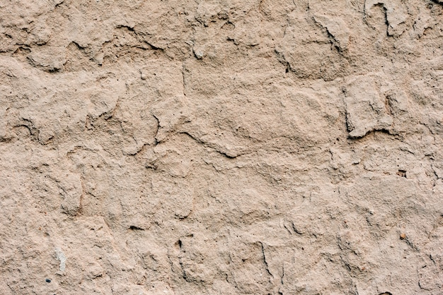 Wall fragment with scratches and cracks Premium Photo
