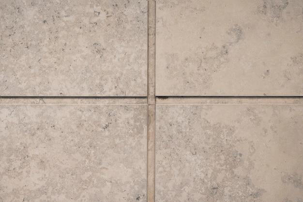 Wall of grey stone blocks Free Photo