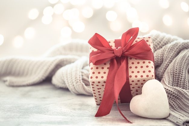 Wall holiday, gift in a beautiful box with a heart . Free Photo