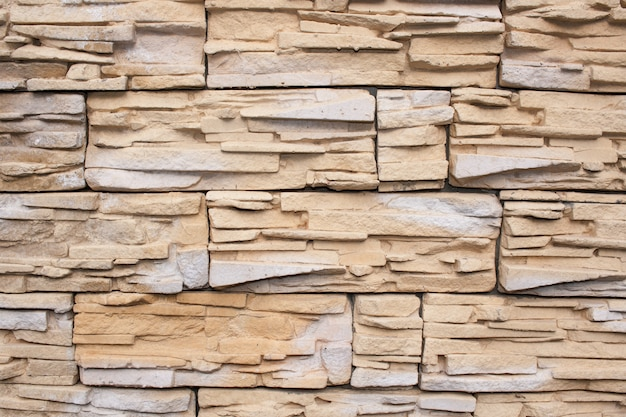 Wall is faced with tiles of  sandstone Premium Photo