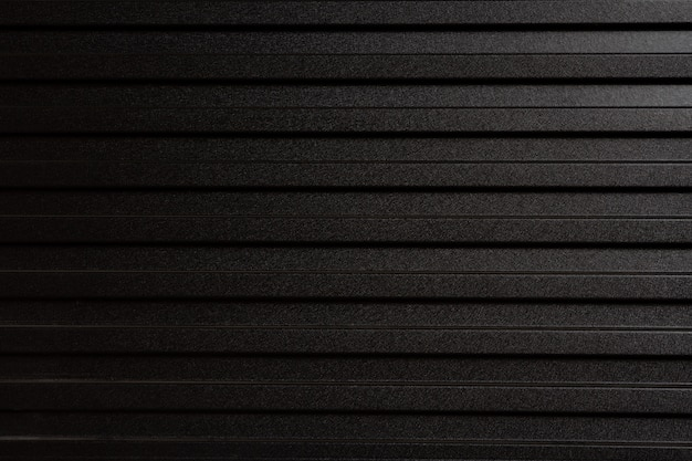 Wall made of gray metal sheet. zinc-like used as a fence to divide construction. Premium Photo
