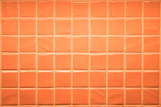 壁タイルタイルピンクサンゴ色背景 Premium写真
