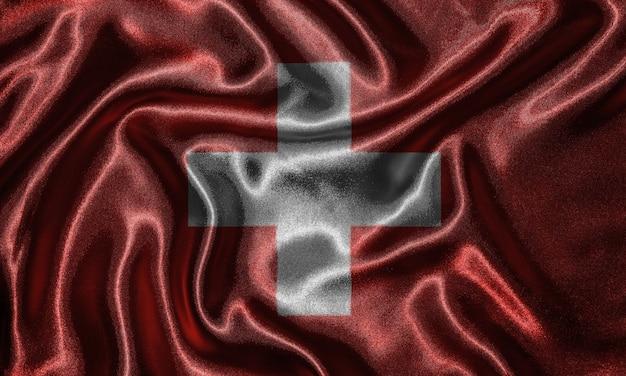 スイスの旗の壁紙と布の旗を振る。 Premium写真