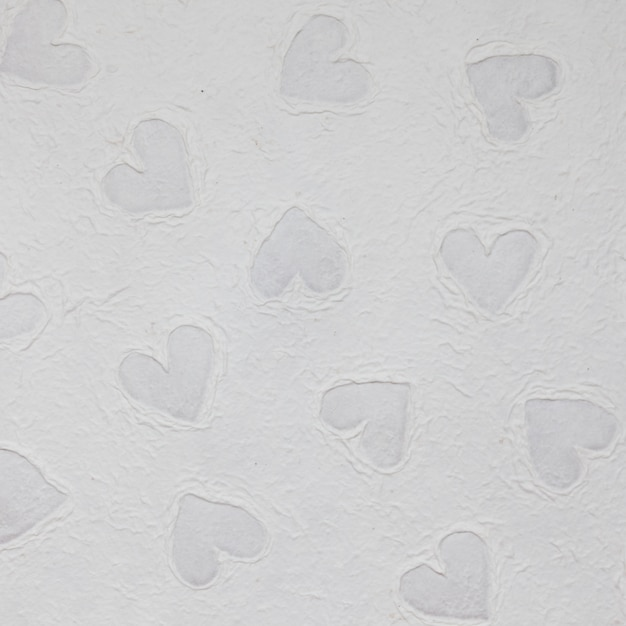 Wallpaper texture with heart shapes Free Photo