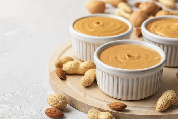 Walnut butter made of peanuts Premium Photo