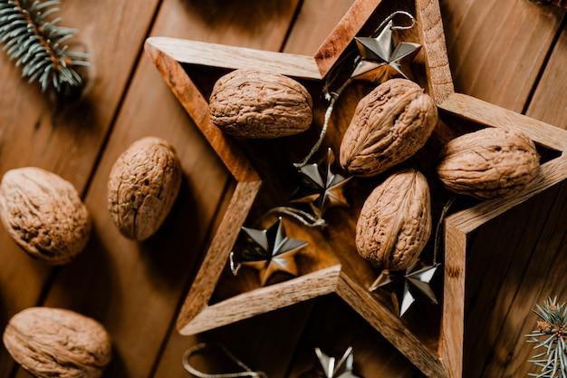 Walnuts in a star frame wallpaper Free Photo
