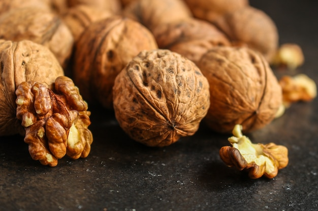 Walnuts, tasty and healthy (kernels, whole nuts) menu . food background. copyspace. top view Premium Photo