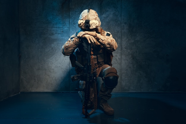 War, army, weapon concept. private military contractor holding rifle Premium Photo
