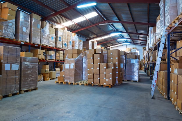Warehouse stograge with stacked boxes in rows Premium Photo