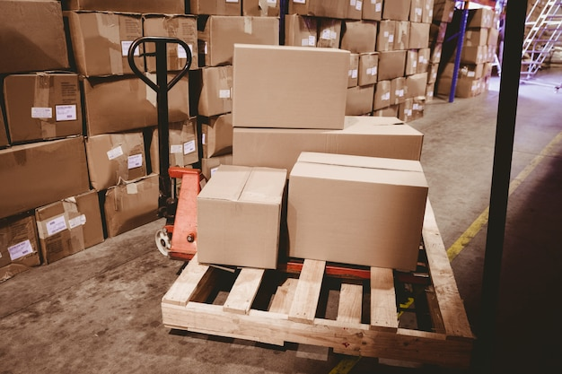 Warehouse with cardboard boxes Premium Photo