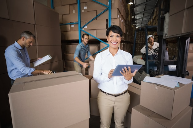 Warehouse workers preparing a shipment Premium Photo