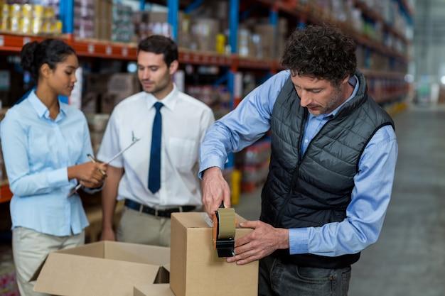 Warehouse workers preparing a shipment Premium Photo
