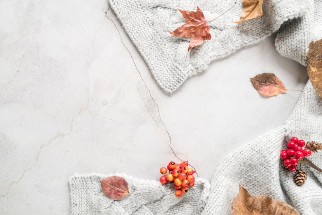Warm knitted scarf on cracked surface Free Photo