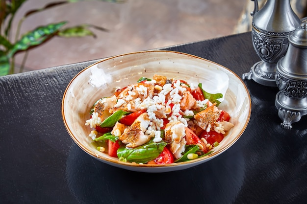 Premium Photo   Warm seafood fish salad. salad with pike perch, quinoa,  spinach and tomato. healthy bowl for lunch. restaurant food concpet.  dieting food concept. grilled fish