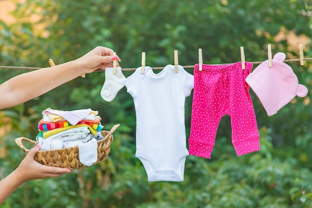 Washing baby clothes, linen dries in the fresh air Premium Photo