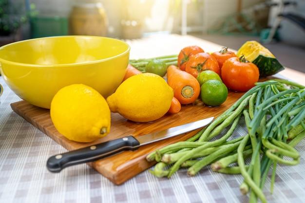 Washing fruits and raw vegetables. Premium Photo