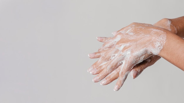 Washing hands rubbing with soap Premium Photo