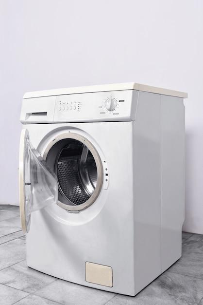 Washing machine with open door at home Premium Photo