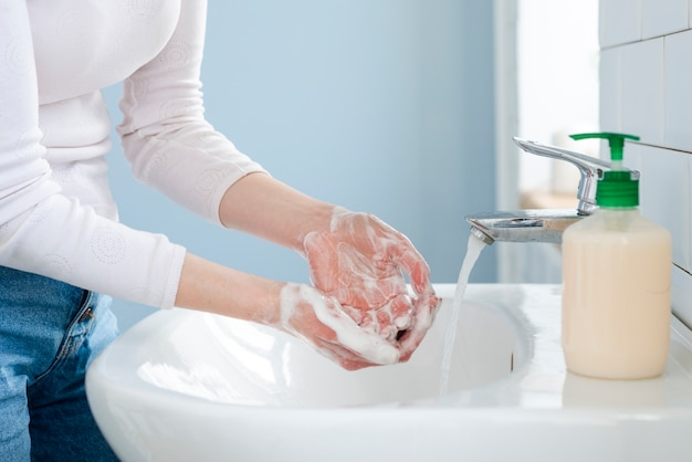 Washing your hands often with water and soap Free Photo