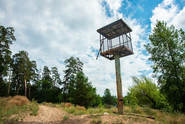 Watch tower in a beautiful landscape on sky backround Premium Photo