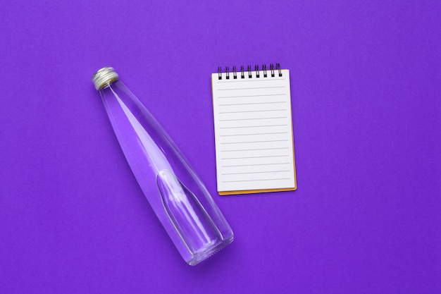 Water bottle flat lay top view on purple paper Premium Photo