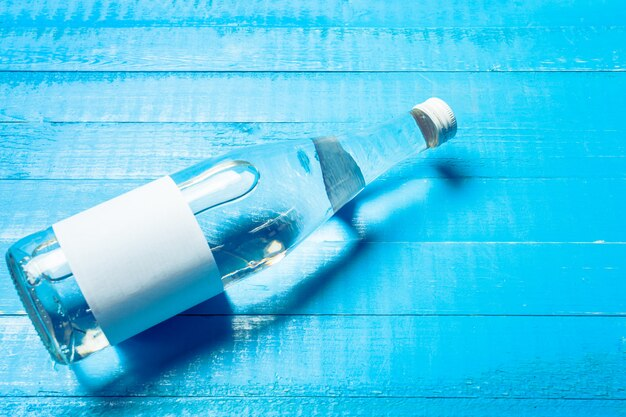 Water bottle on the wooden table Premium Photo