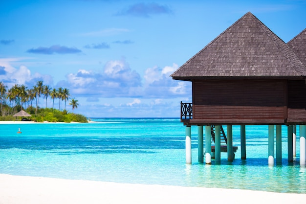 Water bungalows with turquiose water on maldives Premium Photo
