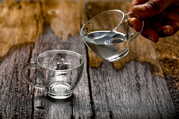 Water in cup on wooden background Premium Photo