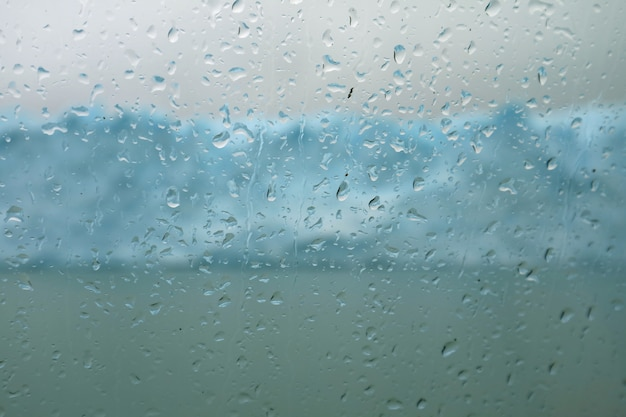 Water droplets on cruise ship glass window, perito moreno glacier, lake argentino, patagonia, argentina Premium Photo