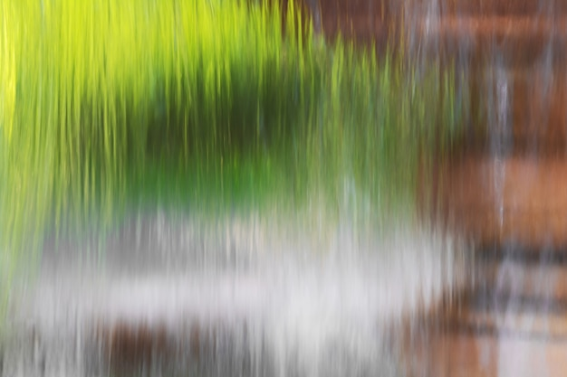 Water flowing from a fountain in the background of the forest. Premium Photo