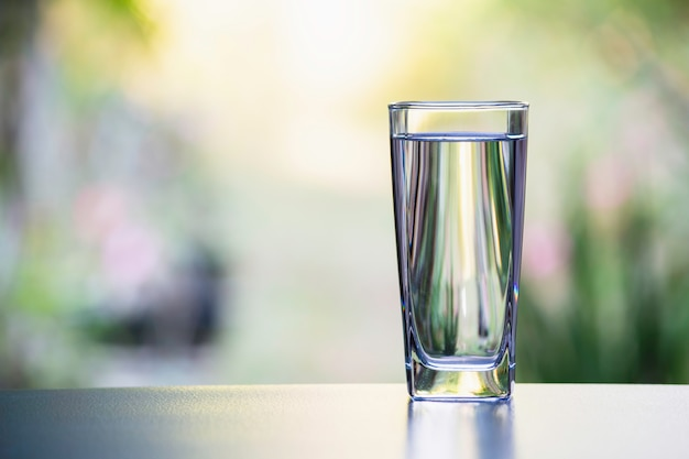 Water In The Glass On Table With Nature Background Premium Photo