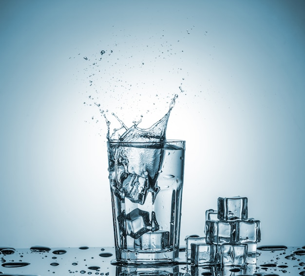 Water in glass with water splash Free Photo