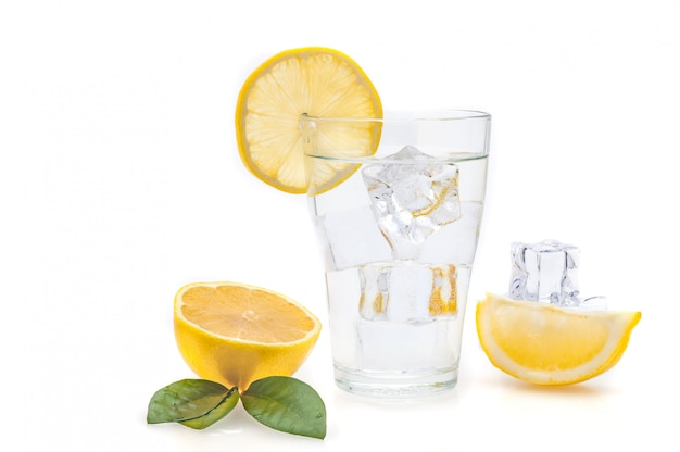 Water, lemon and ice cubes in a glass. lemon slices and flax next to a glass. isolated. Premium Photo