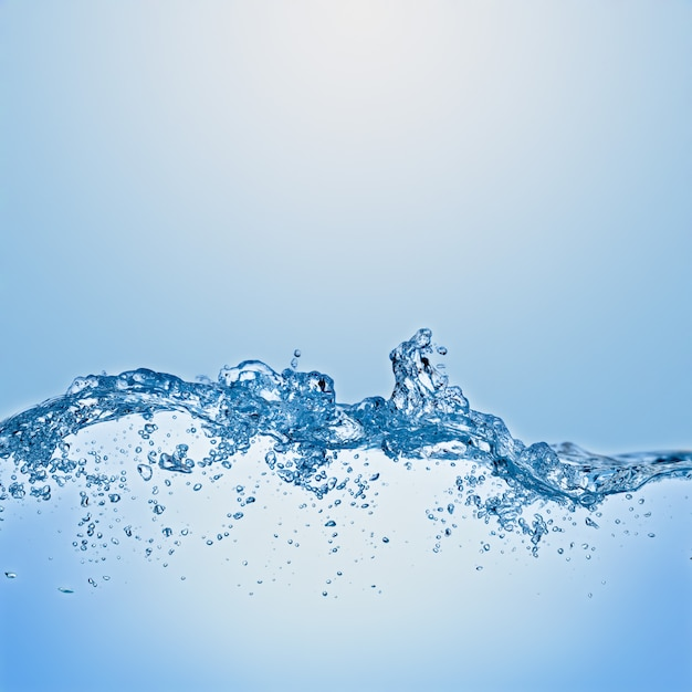 Water splash on blue background Premium Photo